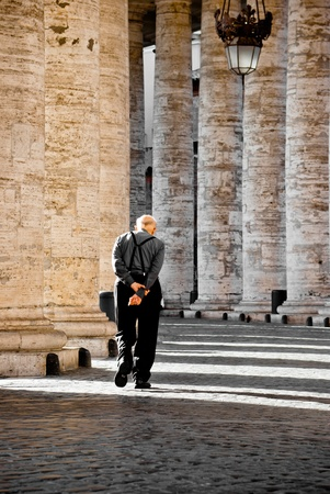 Old man walking in the vatican photo