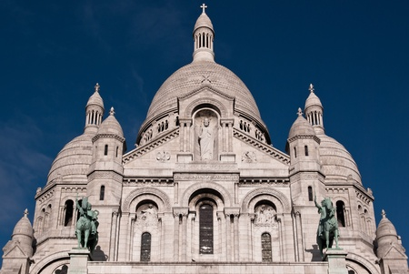 Sacre Couer in sunlight against blue sky photo