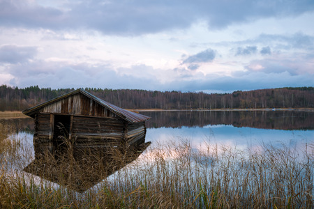 boathouse: Old boathouse on the lake in autumn