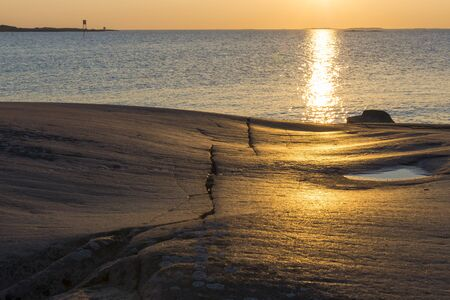 atmosphere: Evening atmosphere on the rocks in the baltic sea