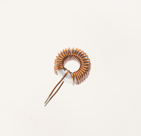 electromagnetism: Copper coils isolated on white background