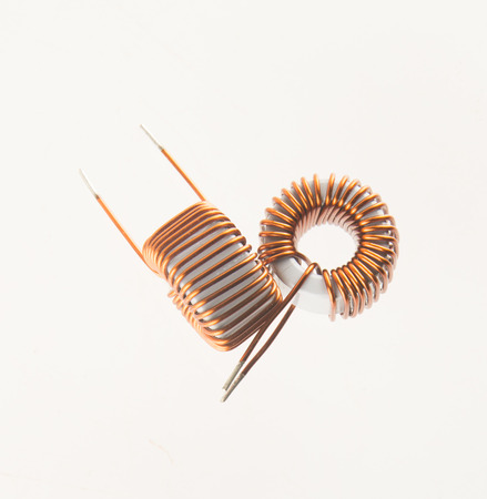 electromagnetism: Copper coils on white background