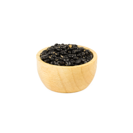 turtle bean: Black beans seed in wood cup isolated on white