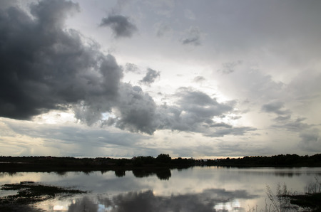a situation alone: Stormy sky over the river
