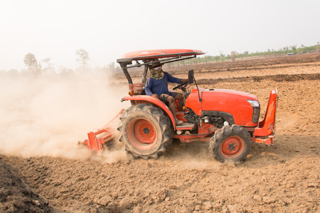 Tractor plows a field shoveling