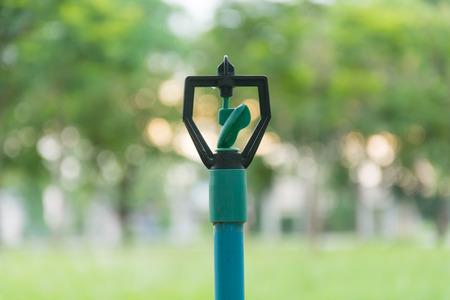 sprinklers: sprinklers watering and bokeh sunset