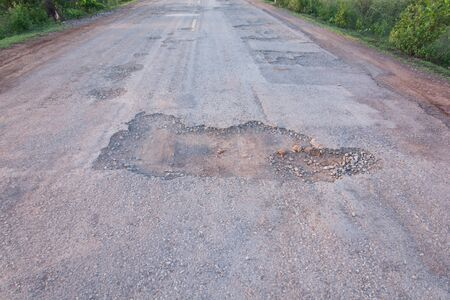 damage control: Hole on damage road way asphalt Stock Photo