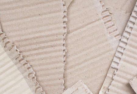 corrugated: corrugated cardboard torn background Stock Photo