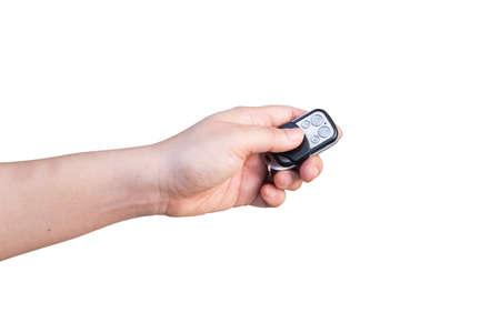 Hand holding car key isolated on white background Stock Photo