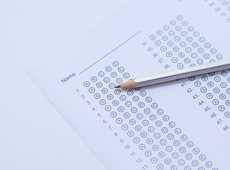 standardized: Standardized test form with answers bubbled in and a pencil