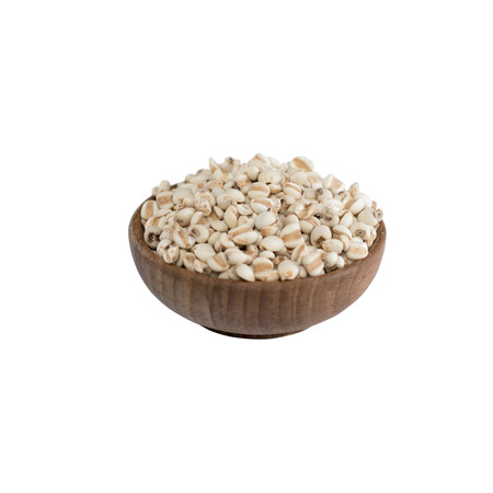mung: Millet rice , millet grains in bowl wood isolated on white