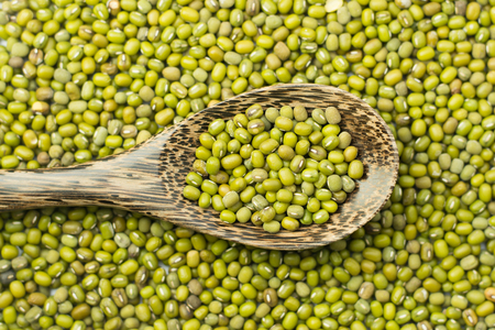 mung beans over wooden background Stock Photo