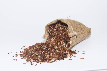 brown rice in jute bag ion white