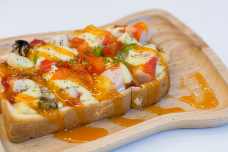 Seafood pizza in wood dish