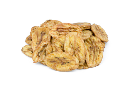 platanos fritos: Dried banana slices isolated on white background Foto de archivo