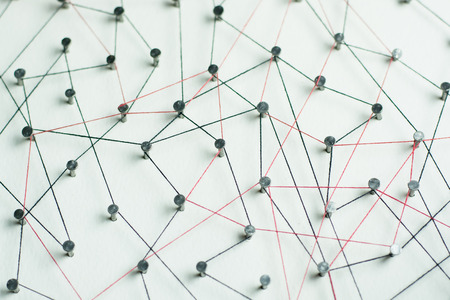 Linking entities. Network, networking, social media, internet communication abstract. A small network connected to a larger network. in wood linked together by cotton with a black and red tint