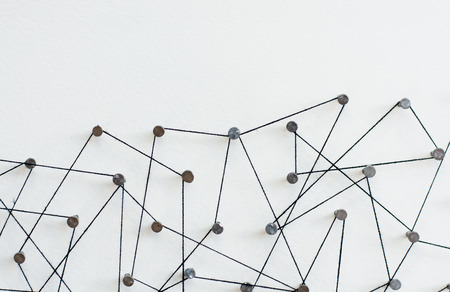 Linking entities. Network, networking, social media, internet communication abstract. A small network connected to a larger network. in paper linked together by cotton with a black tint