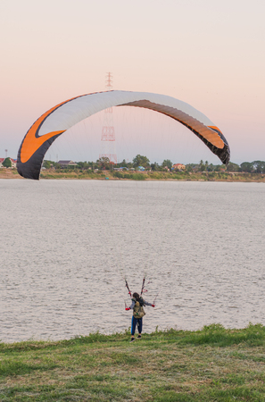 young woman parachuting down to the ground Riverside
