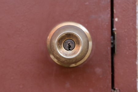 Door Knob And Keyhole Made Of Brass On The Old Wooden Door Stock Photo,  Picture And Royalty Free Image. Image 80039945.