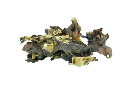 cloud ear fungus: Dried chinese delicacy black muer fungus isolated over white
