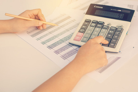 information analysis: Business concept : Financial accounting stock market graphs analysis. Stock Photo