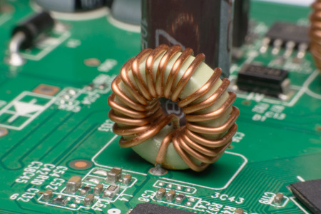 Inductor copper coils on the circuit board Stock Photo