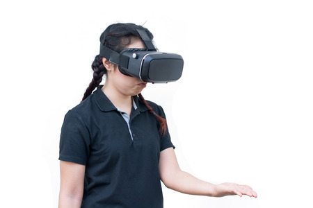 young casual woman using Virtual reality headset isolated on white Stock Photo