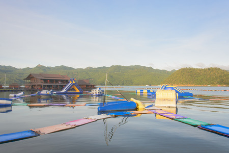 inflatable water park on the lake with The mountain in the background,kanchanaburi,thailand