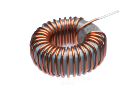Close up inductor copper coils isolated on white background