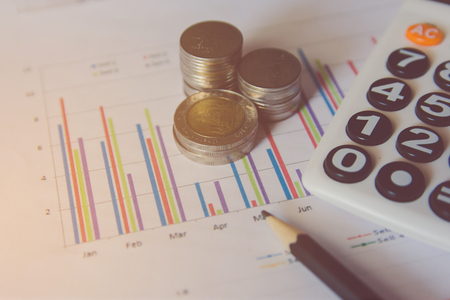 coins stack, calculator, Pencil on Financial data analyzing, finance and banking concept Stock Photo