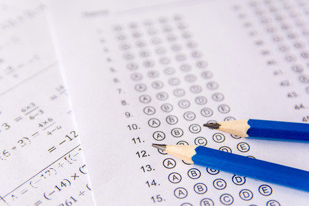 Pencil on answer sheets or Standardized test form with answers bubbled. multiple choice answer sheet Banco de Imagens