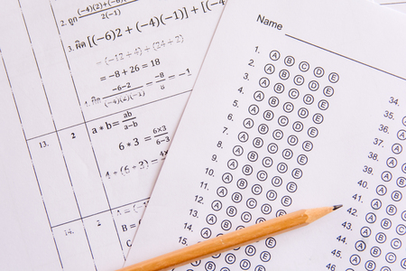 Pencil on answer sheets or Standardized test form with answers bubbled. multiple choice answer sheet Foto de archivo