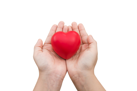 Red heart ball : Stress reliever foam ball the red heart shape on woman hand isolated on white background