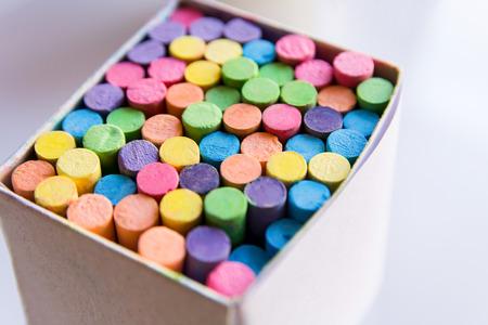 Colorful chalk in a cardboard box, Box of chalk on white background Archivio Fotografico