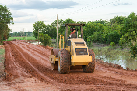 NAKHONPHANOM, THAILAND - July 1, 2018 : Roller steamroller or vibratory roller machine working on road construction site of new road.