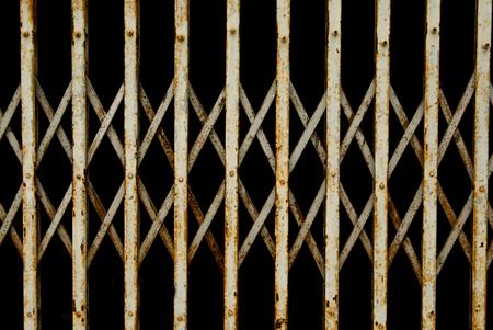 Old folding metal door gate. old rusty iron slide door