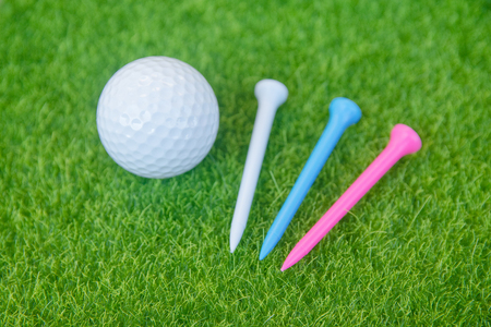 Golf ball and tee on green grass ready to play at golf course. with copy space