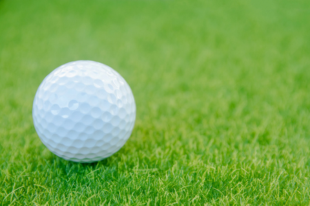 Golf ball on green grass ready to play at golf course. with copy space Standard-Bild - 115371630