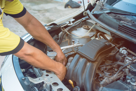 Car mechanic working with wrench in garage. Repair service. Standard-Bild - 115372144