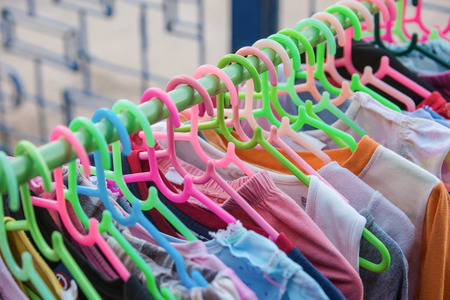 Colorful clothes Hanger on a shelf