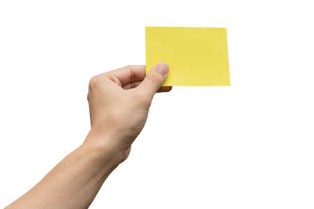 Hand holding yellow paper isolated on white with clipping path Stock fotó