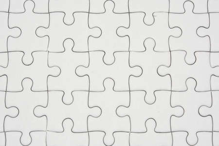 White jigsaw puzzle pattern background.