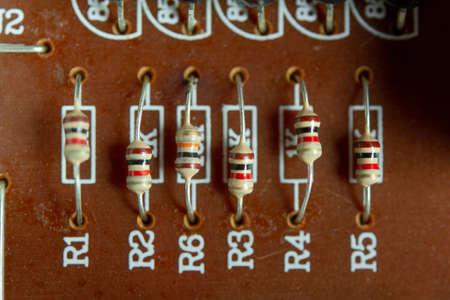 Closeup electronic hardware .Resistor on the white circuit board 免版税图像
