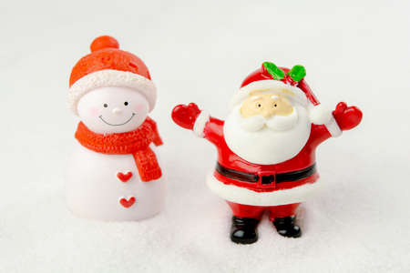 Merry Christmas and happy new year concept. Cute santa claus figure on snow with copy space Stock Photo