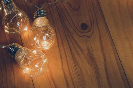 Light bulbs over wooden background