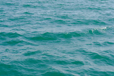 sea wave close up. Ripple on the surface background