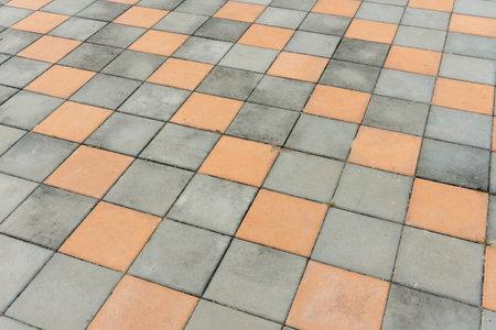 Dirty Paving block. Street cement block floor background Standard-Bild