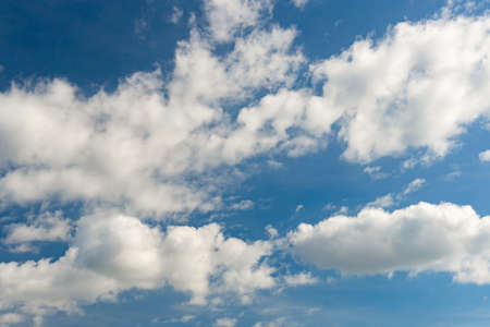 Cirrus and cumulus clouds on blue sky background.