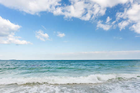 Sea waves and blue sky on sunny day background. copy space