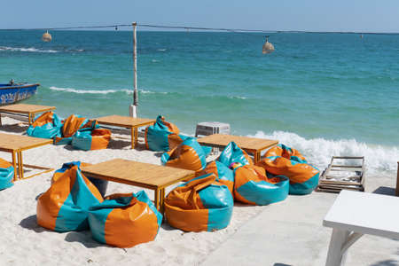 Bean bags and table on the beach.